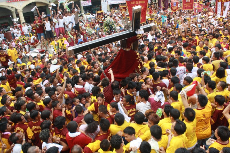 A statue of Christ on the cross is carried through the streets of Manila during the Black Nazarene Festival (Pista ng Itim na Nazareno). The Philippines is one of only two predominantly Catholic countries in Asia. Photo by Denvie Balidoy (CC BY 2.0)