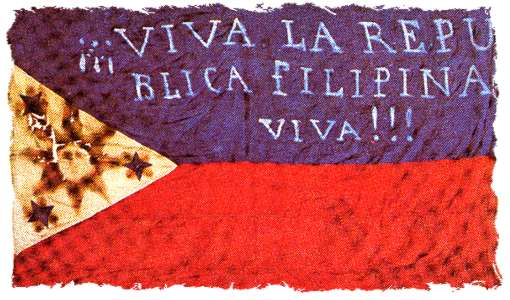"Early flag of the Filipino revolutionaries (""Long live the Philippine Republic!""). The first two constitutions were written in Spanish. Photo: ""Bandera 03"". Licensed under Public Domain via Wikimedia Commons ."